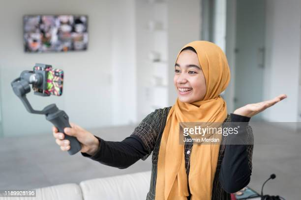 girl making video using smartphone and steady - live streaming stock pictures, royalty-free photos & images