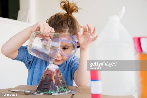 girl making volcano - science stock pictures, royalty-free photos & images