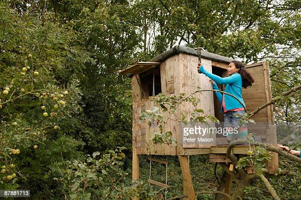 girl mending treehouse - tree house stock pictures, royalty-free photos & images