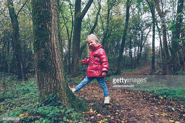 Girl messing about in the woods, Ritthem, Zeeland, Holland