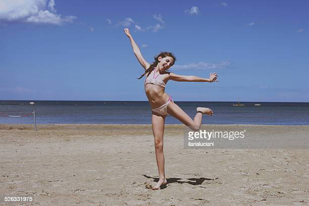 Girl messing about on beach