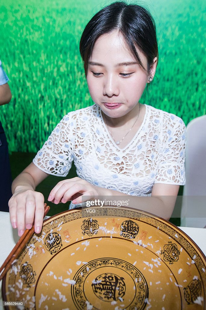 Girl Mi Zijun eats cooked rice on a taste test competition on August 2, 2016 in Hangzhou, Zhejiang Province of China. Wuchang Municipal Government has signed exclusive contract with Alibaba Group to take Tmall Supermarket as the only retailer in electric businesses and held a test eating activity in Hangzhou. A girl named Mi Zijun who's known as a 'big eater' on the internet attracted crowds as she ate up over four kilograms of cooked rice as well as two bottles of mineral water.
