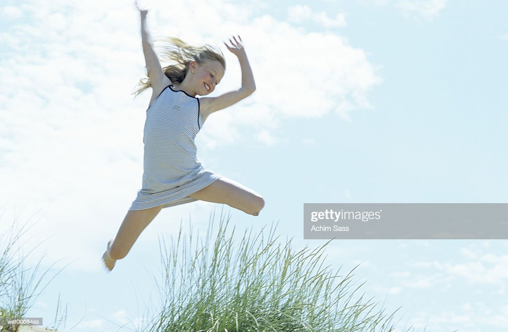 Girl mid air : Foto de stock