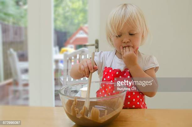 Girl mixing and baking
