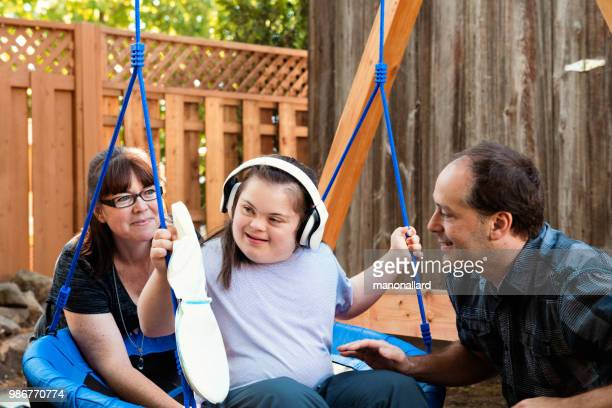 girl Mother, father with their Autistic and Down Syndrome Twins daughter in daily lives