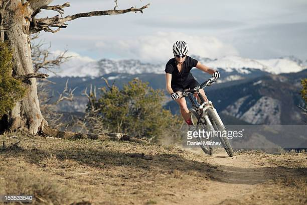 girl mountain biking on a scenic trail. - turning stock pictures, royalty-free photos & images