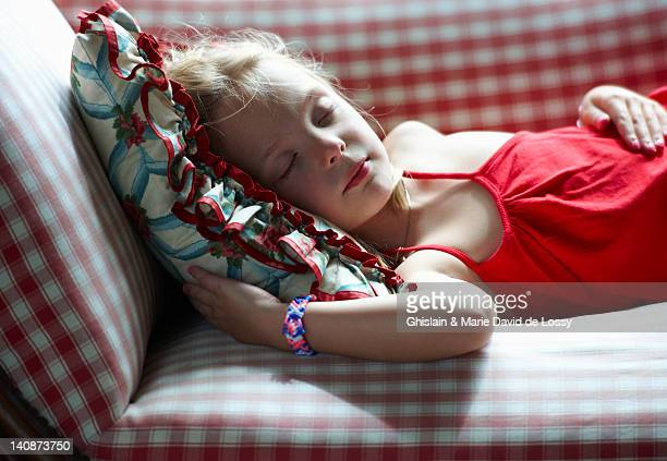 girl napping on couch - saint ferme stock photos and pictures