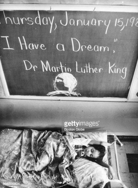 A girl naps under a quote from Dr Martin Luther King at the Martin Luther King Avenue Christian School in Washington DC on Jan 21 Martin Luther King...