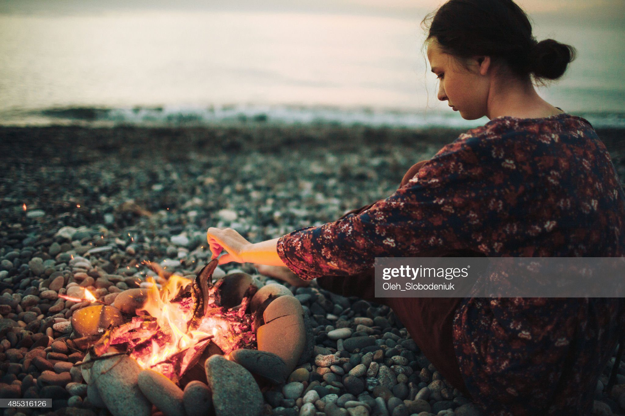 Girl near the fireplace : Stock Photo