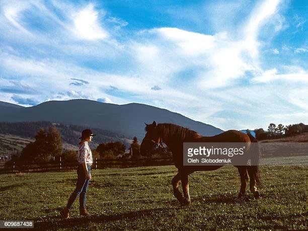 Girl near the horse