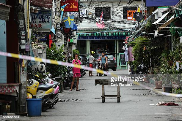 A girl observes the site of an explosion on Friday August 12 2016 in Hua Hin Thailand A series of coordinated blasts across Southern Thailand...