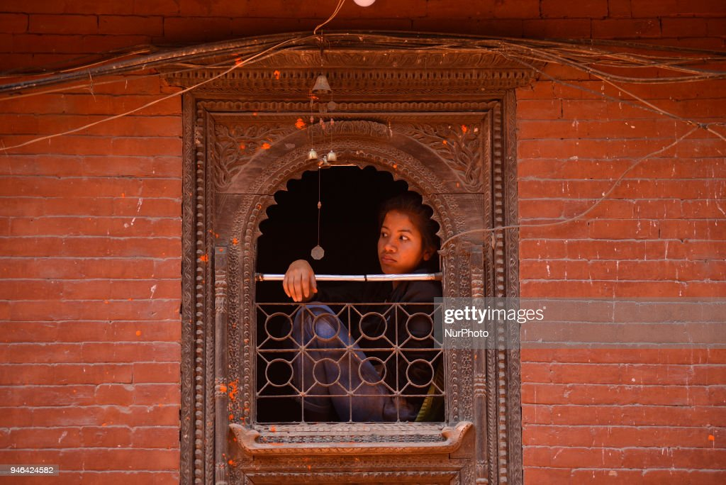 """A girl observing the festival during the celebration of """"Sindoor Jatra"""" vermillion powder festival as Nepalese New Year day celebration at Thimi, Bhaktapur, Nepal on Sunday, April 15, 2018."""