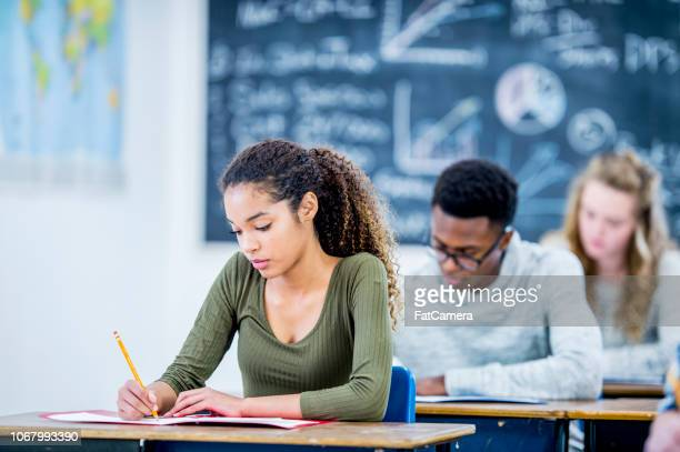 girl of african descent studying - teenagers only stock pictures, royalty-free photos & images