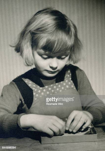 girl of five playing. switzerland in the 1940's. - 1940 1949 stock pictures, royalty-free photos & images
