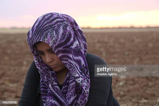 A girl of Syrian Kurdish Azad Azad family fled from the clashes between Islamic State of Iraq and the Levant and Syrian Kurdish armed groups in Ayn...
