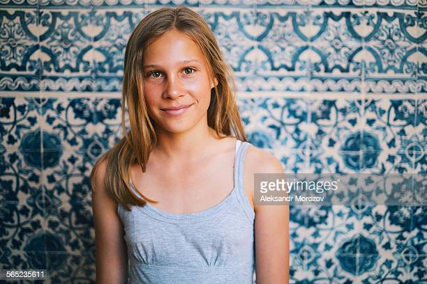 Girl on a background of blue tiles