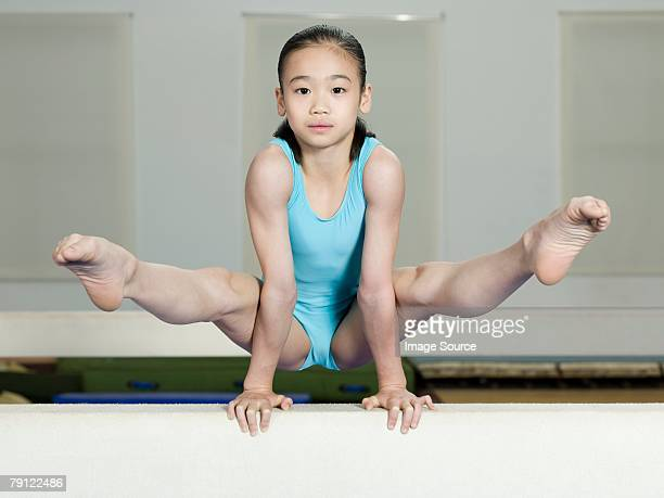 girl on a balance beam - little girls leotards stock photos and pictures