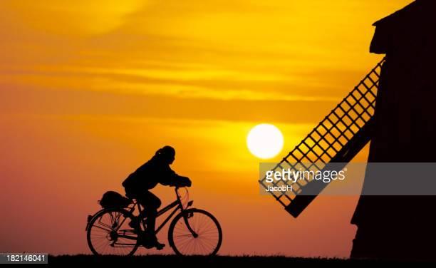 Girl on a bike in Dutch Setting