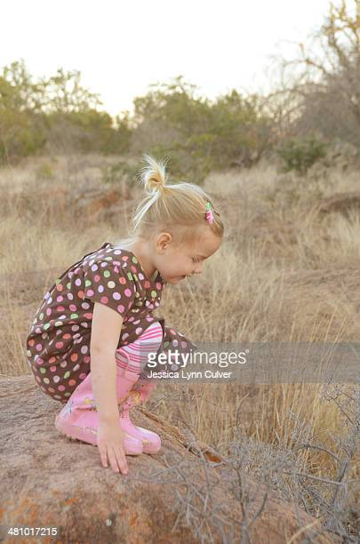 girl on a granite boulder wearing rubber galoshes - lynn pleasant photos et images de collection