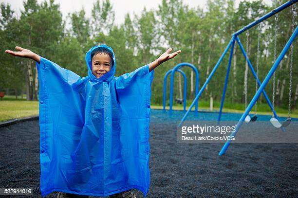 Girl on a rainy playground
