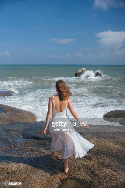 girl on a rock at the ocean - one young woman only stock pictures, royalty-free photos & images
