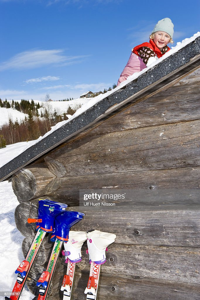 A girl on a roof in the snow. : Stock Photo