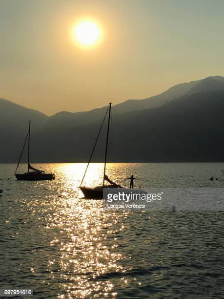 Girl on a sailboat at Sunset, Lake Garda, Italy