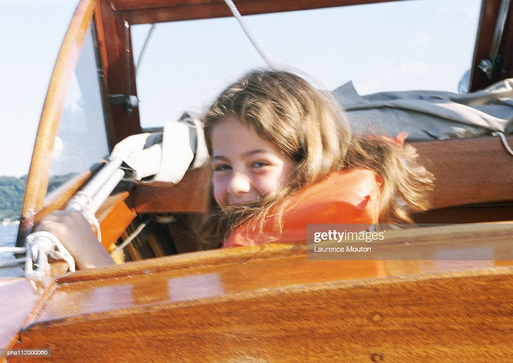 Girl on a speed boat, looking at camera : Stockfoto