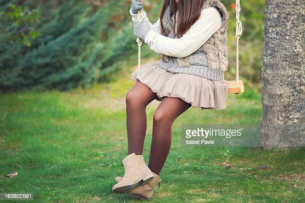 girl on a swing - little girls in tights stock photos and pictures