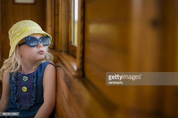Girl on a train looking out of the window