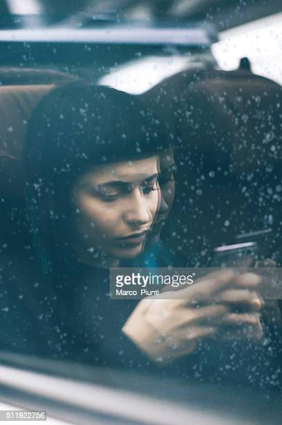 Girl on a train using smartphone