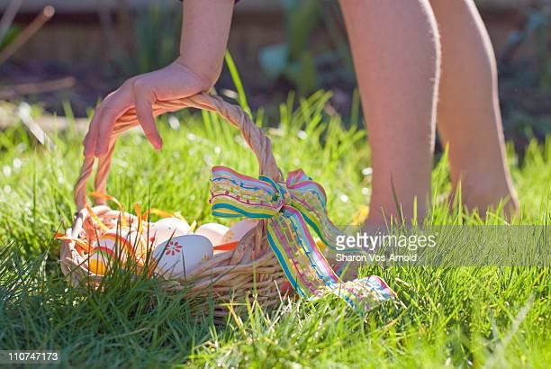girl on an easter egg hunt in garden - osternest stock-fotos und bilder