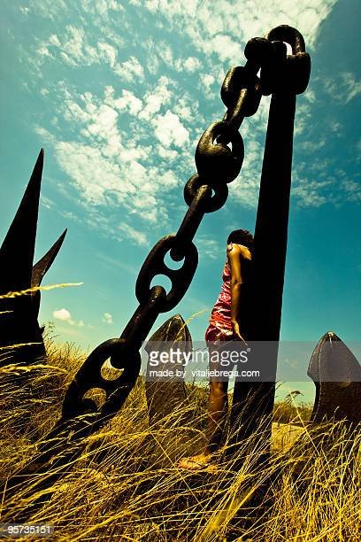 Girl on anchor with chains in the field