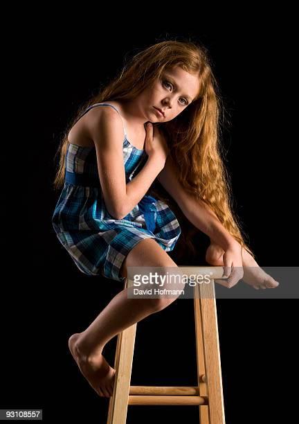 Girl on bar stool