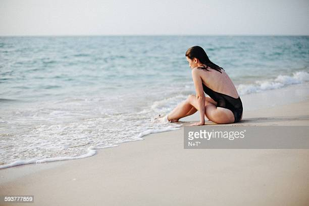 girl on beach - n n girl model stock photos and pictures