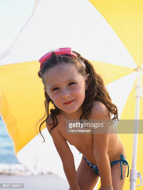 girl on beach - one piece swimsuit stock pictures, royalty-free photos & images