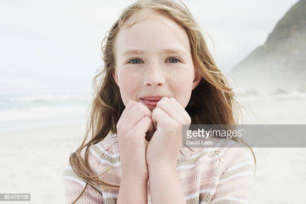 Girl on beach, smiling, portrait