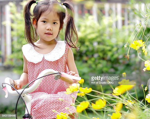 Girl on bicycle in sunny day