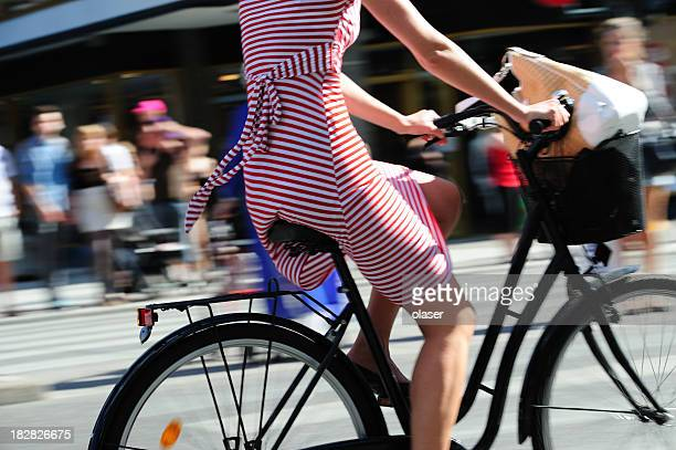 Girl on bicycle in traffic