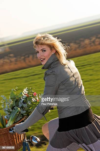 girl on bicycle - flevoland stockfoto's en -beelden