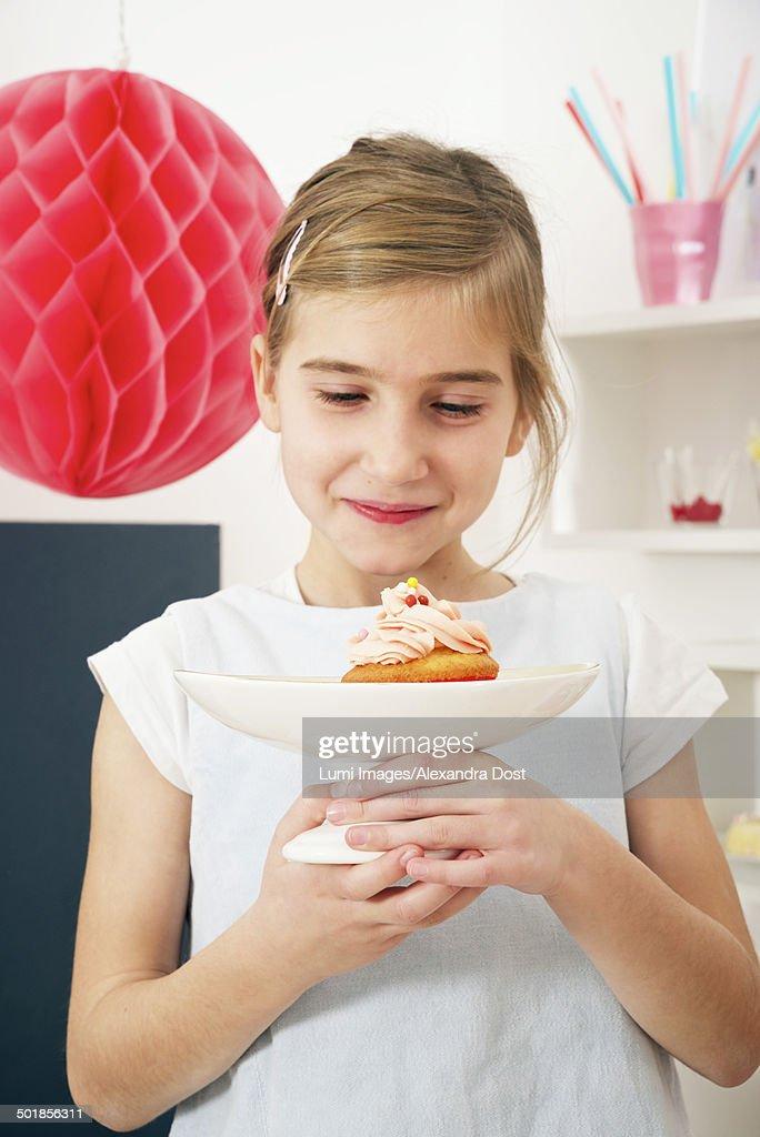 Girl On Birthday Looking At Cake Munich Bavaria Germany Stock Photo