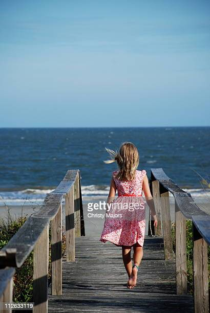 Girl on boardwalk