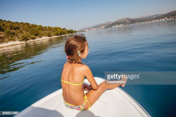girl on boat trip enjoying in the view from the bow - only girls stock pictures, royalty-free photos & images