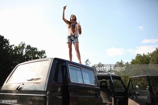 Girl on car enjoying bubble tea