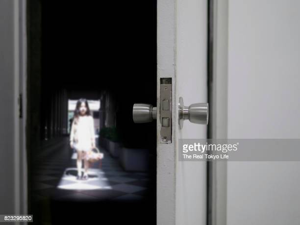 girl on doorway - horror movie stock photos and pictures