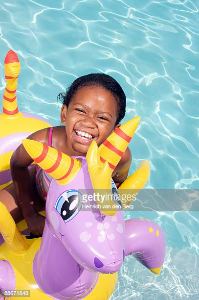 girl on floater in swimming pool, pietermaritzburg, kwazulu-natal province, south africa - pietermaritzburg stock pictures, royalty-free photos & images