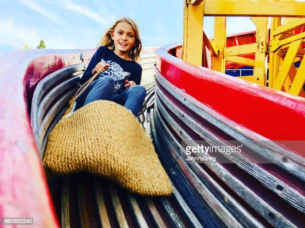 girl on helterskelter at funfair - carnival stock pictures, royalty-free photos & images