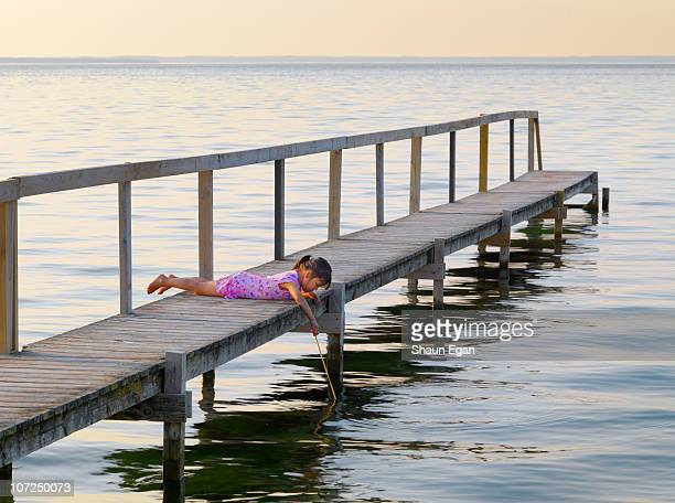 girl on jetty looking in sea - funen stock pictures, royalty-free photos & images