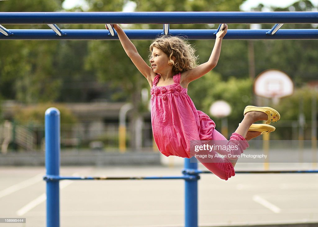 Girl on monkey bars : Stock Photo