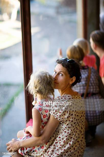 Girl on mothers lap at zoo